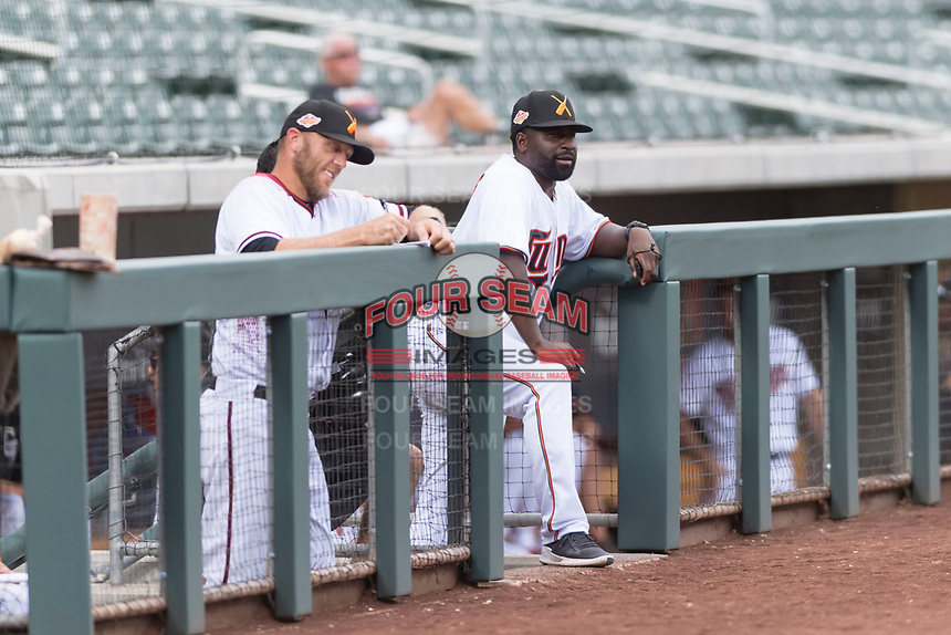 Salt River Rafters manager Tommy Watkins (8), of the Minnesota Twins organization, and hitting coach Shelley Duncan (18), of the Arizona Diamondbacks organization, in the dugout during an Arizona Fall League game against the Surprise Saguaros at Salt River Fields at Talking Stick on October 23, 2018 in Scottsdale, Arizona. Salt River defeated Surprise 7-5 . (Zachary Lucy/Four Seam Images)