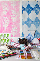Samples of Molly Mahon fabrics and wallpapers.