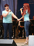 Lisa Howard and Sierra Boggess performing at United presents 'Stars in the Alley' in  Shubert Alley on May 27, 2015 in New York City.