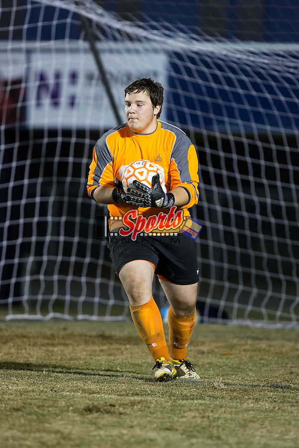 Grayson Owens (00) of the Carson Cougars makes a save during second half action against the Asheville Cougars at Jesse C. Carson High School on November 12, 2015 in China Grove, North Carolina.  The Asheville Cougars defeated the Carson Cougars 3-2 in the third round of the 2015 NCSHAA 3A playoffs.  (Brian Westerholt/Sports On Film)