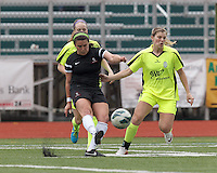 North Reading, Massachusetts - June 14, 2014:  In a Women's Premier Soccer League (WPSL) match, Boston Aztec (black) tied New England Mutiny (yellow), 1-1, at North Reading High School Stadium on Arthur J. Kenney Athletic Field.