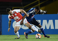 BOGOTÁ - COLOMBIA, 18-09-2018: Diego Guastavino (Izq) jugador de Independiente Santa Fe disputa el balón con Omar Bertel (Der) jugador de Millonarios durante partido de ida por los octavos de final de la Copa CONMEBOL Sudamericana 2018 jugado en el estadio Nemesio Camacho El Campín de la ciudad de Bogotá. / Diego Guastavino (L) player of Independiente Santa Fe vies for the ball with Omar Bertel (R) player of Millonarios during first leg match for the eight finals of CONMEBOL Sudamericana 2018 cup played at Nemesio Camacho El Campin stadium in Bogotá city.  Photo: VizzorImage / Gabriel Aponte / Staff