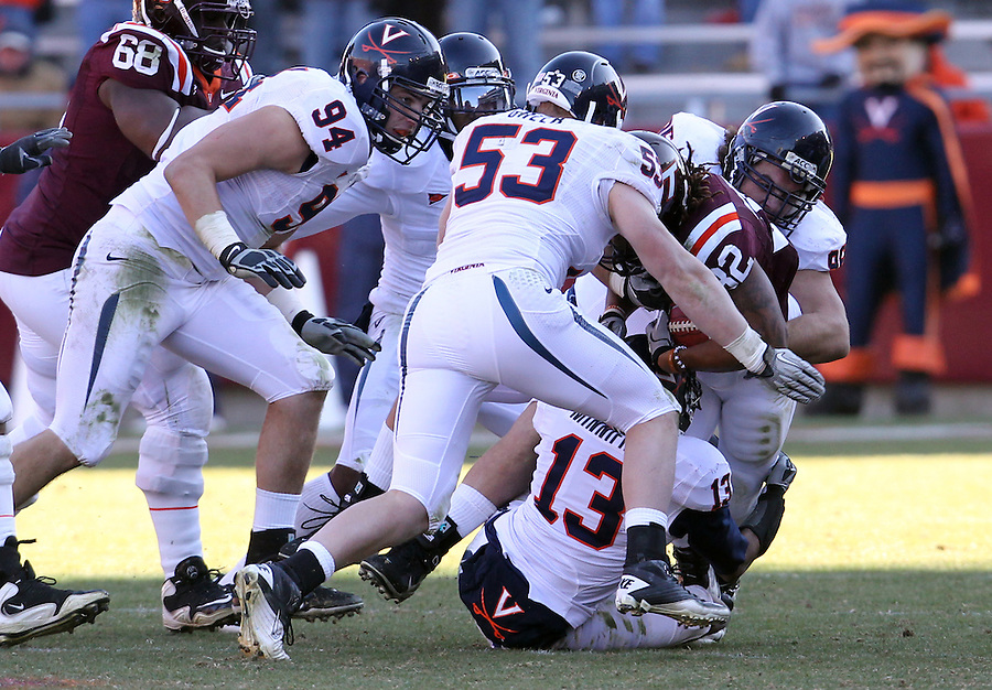 Nov 27, 2010; Charlottesville, VA, USA;  Virginia Cavaliers defensive end Matt Conrath (94) and Virginia Cavaliers linebacker Steve Greer (53) during the game at Lane Stadium. Virginia Tech won 37-7. Mandatory Credit: Andrew Shurtleff-