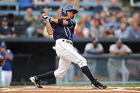 Asheville Tourists center fielder Rafael Ortega #5 swings at a pitch during a game against the Rome Braves at McCormick Field on August 18, 2011 in Asheville, North Carolina. Rome won the game 12-11.   (Tony Farlow/Four Seam Images)