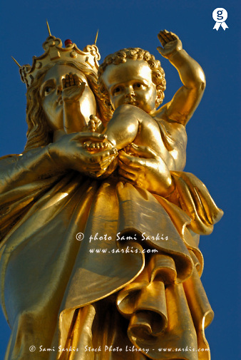 France, Marseille, close up of statue of Virgin Mary with Infant on Notre-Dame de la Garde Basilica, low angle view (Licence this image exclusively with Getty: http://www.gettyimages.com/detail/74583313 )