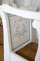 Detail of a hand-painted Swedish kitchen settle