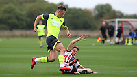 Brentford's Nikolaj Kirk tackles Oliver Dyson of Huddersfield Town during Brentford B vs Huddersfield Town Under-23, Friendly Match Football at Brentford FC Training Ground, Jersey Road on 12th September 2018