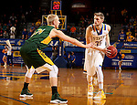 BROOKINGS, SD - DECEMBER 28:  A.J. Hess #35 from South Dakota State looks for a teammate around the defense of Cameron Hunter #21 from North Dakota State during their game Wednesday night at Frost Arena in Brookings. (Dave Eggen/Inertia)