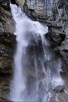 Close-up of water cascading over sheer rocks of Panther Falls in Banff National Park, Alberta.