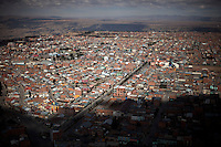 A panoramic view of El Alto.Just 25 years ago it was a small group of houses around La Paz  airport, at an altitude of 12,000 feet. Now El Alto city  has  nearly one million people, surpassing even the capital of Bolivia, and it is the city of Latin America that grew faster .<br /> 	It is also a paradigmatic city of the troubles  and traumas of the country. There got refugee thousands of miners that lost  their jobs in 90 &acute;s after the privatization and closure of many mines. The peasants expelled by the lack of land or low prices for their production. Also many who did not want to live in regions where coca  growers and the Army  faced with violence.<br /> 	In short, anyone who did not have anything at all and was looking for a place to survive ended up in El Alto.<br /> 	Today is an amazing city. Not only for its size. Also by showing how its inhabitants,the poorest of the poor in one of the poorest countries in Latin America, managed to get into society, to get some economic development, to replace their firs  cardboard houses with  new ones made with bricks ,  to trace its streets,  to raise their clubs, churches and schools for their children.<br /> 	Better or worse, some have managed to become a sort of middle class, a section of the society that sociologists call  emerging sectors. Many, maybe  most of them, remain for statistics as  poor. But clearly  all of them have the feeling they got  for their children a better life than the one they had to face themselves .