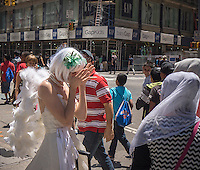 Margot Carr, a performance artist, actress and mime known as NY Pearl the Mime performs for visitors to Times Square in New York on Wednesday, June 19, 2013. Carr has recently returned from a theatrical promo tour with Cirque  du  Soleil. (© Richard B. Levine)
