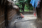 A woman washes the dishes outside her hut in Shivpur Hariyya village in Raxaul district of Bihar.