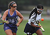 Nadia Elcock #15 of Baldwin, right, gets pressured by Devon DiVello #20 of New Hyde Park during a Nassau County Conference I varsity field hockey match at Baldwin High School on Wednesday, Sept. 28, 2016. Baldwin won by a score of 2-0.