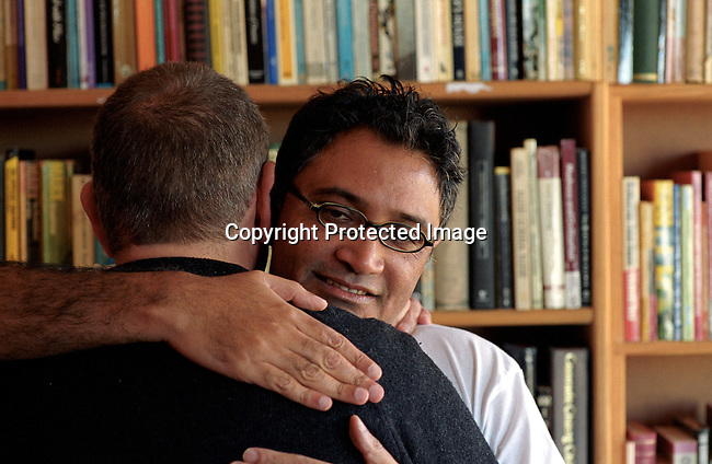 Zachie Achmat, the head of TAC, Treatment Action Campaign, a HIV-Aids activist organization, hugging a friend in his study in his house in Muizenberg outside Cape Town, South Africa. TAC is fighting for the delivering of antiretroviral drugs to all South African, specially pushing the government to take action..Photo: Per-Anders Pettersson/ iAfrika Photos.