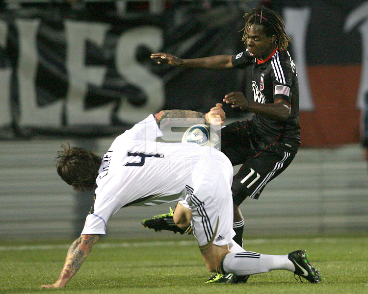 Joseph Ngwenya(11) of D.C. United attempts to lift the ball over Danny Califf(4) of the Philadelphia Union during a play-in game for the US Open Cup tournament at Maryland Sportsplex, in Boyds, Maryland on April 6 2011. D.C. United won 3-2 after overtime penalty kicks.