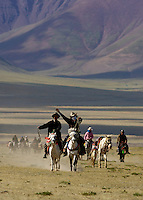High up and near the edge of Namtso Lake, Tibet Nomads and their Horses, the lake is the highest saltwater lake in Tibet and the world at 4800 meters plus
