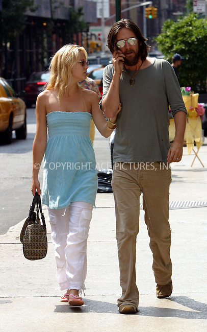Very pregnant Kate Hudson and her tattooed musician husband Chris Robinson pictured taking a stroll in New York's SoHo. Once again, Hudson proved having a superb sense of style as she wore casual blue strapless mini dress, white pants, pink flip-flops and carried Fendi bag. New York, July 8, 2003. Please byline: NY Photo Press.  ..*PAY-PER-USE*      ....NY Photo Press:  ..phone (646) 267-6913;   ..e-mail: info@nyphotopress.com