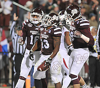 NWA Media/Michael Woods --11/01/2014-- w @NWAMICHAELW... Mississippi State running back Josh Robinson (13) celebrates with his team after scoring a touchdown in the 2nd quarter of Saturday nights game against Arkansas at Davis Wade Stadium in Starkville, Mississippi.