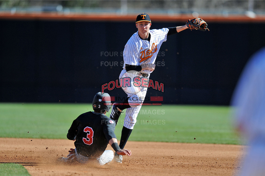 Tennessee Volunteers shortstop A.J. Simcox #10 makes the turn to complete a double play over a hard sliding Joey Armstrong #3 during a game against the UNLV Runnin' Rebels at Lindsey Nelson Stadium on February 22, 2014 in Knoxville, Tennessee. The Volunteers defeated the Rebels 5-4. (Tony Farlow/Four Seam Images)