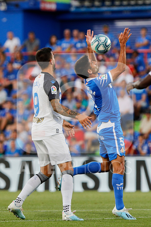 Leandro Cabrera of Getafe CF and Jose Luis Mato 'Joselu' of Deportivo Alaves during La Liga match between Getafe CF and Deportivo Alaves at Colisseum Alfonso Perez in Getafe, Spain. August 31, 2019. (ALTERPHOTOS/A. Perez Meca)