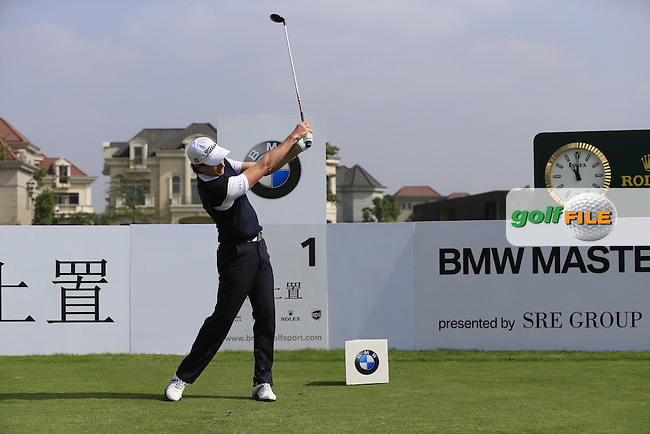 Brett Rumford (AUS) tees off the 1st tee to start his match during Saturday's Round 3 of the 2013 BMW Masters presented by SRE Group held at Lake Malaren Golf Club, Shanghai, China. 26th October 2013.<br /> Picture: Eoin Clarke/www.golffile.ie