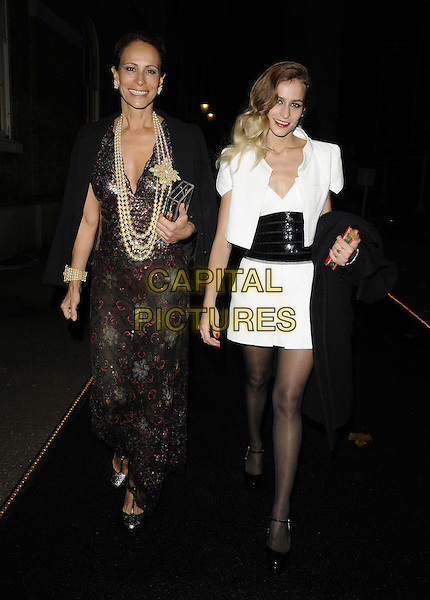Andrea Dellal & Alice Dellal.The 'Chanel: The Little Black Jacket' private view, Saatchi Gallery, London, England..October 11th, 2012.full length white black jacket dress waistband sequins sequined red clutch bag brown print dress pearls necklace mother mom mum daughter family .CAP/CAN.©Can Nguyen/Capital Pictures.