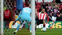 Bryan Mbeumo of Brentford tries to shake off a challenge during Brentford vs Luton Town, Sky Bet EFL Championship Football at Griffin Park on 30th November 2019