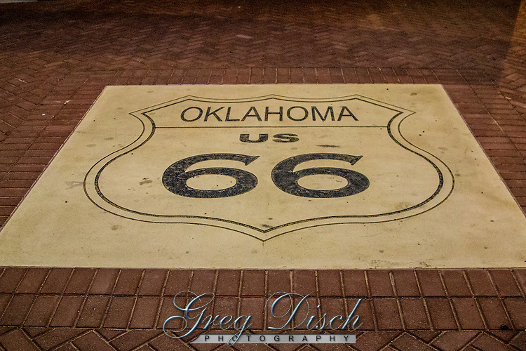 Oklahoma  66 shield at the Medow Gold sign pavillion.<br /> <br /> The Meadow Gold Sign has been a Route 66 icon since the 1930's.  Originally located at 11th and Lewis streets along historic route 66. A few years ago the builing it was mounted on was demolished but the sign was removed, restored and placed on a pavilion at 11th and Quaker.