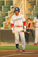 Angelo Mora (18) of the Lakewood BlueClaws looks to his third base coach for the signs during the South Atlantic League game against the Kannapolis Intimidators at CMC-Northeast Stadium on August 14, 2013 in Kannapolis, North Carolina.  The Intimidators defeated the BlueClaws 10-2.  (Brian Westerholt/Four Seam Images)