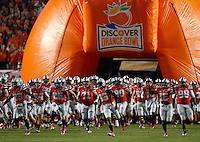 The Ohio State Buckeyes take the field before the Discover Orange Bowl between Ohio State and Clemson at Sun Life Stadium in Miami Gardens, Florida, Friday night, January 3, 2014. As of half time the Ohio State Buckeyes led the Clemson Tigers 22 - 20.(The Columbus Dispatch / Eamon Queeney)
