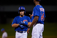 AZL Cubs 1 Herson Perez (4) is congratulated by coach Chris Pieters (14) after hitting a single during an Arizona League game against the AZL Royals on June 30, 2019 at Sloan Park in Mesa, Arizona. AZL Royals defeated the AZL Cubs 1 9-5. (Zachary Lucy/Four Seam Images)