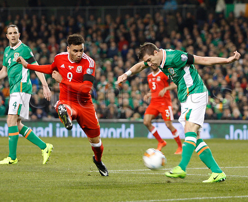 March 24th 2017, Aviva Stadium, Dublin, Republic of Ireland; World Cup 2018 Qualifier mens football, Republic of Ireland versus Wales; Stephen Ward clears the ball as Hal Robson-Kanu closes in