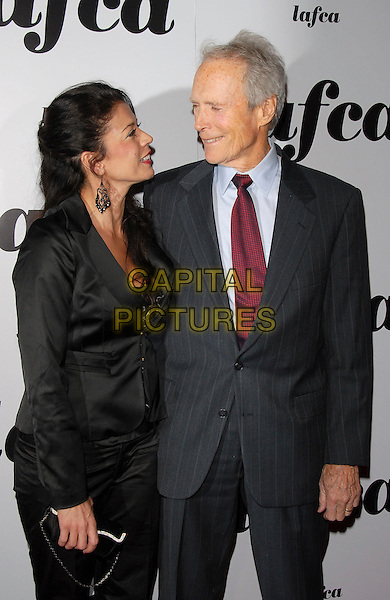 DINA EASTWOOD & CLINT EASTWOOD.attends The 32nd Annual Los Angeles Film Critics Association Awards (LAFCA) held at The InterContinental Los Angeles in Century City, California, USA, .January 14 th 2007..half length .CAP/DVS.©Debbie VanStory/Capital Pictures