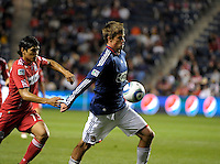 Chivas forward Justin Braun (17) plays the ball in front of Chicago defender Deris Umanzor (13).  The Chicago Fire tied Chivas USA 1-1 at Toyota Park in Bridgeview, IL on May 1, 2010.