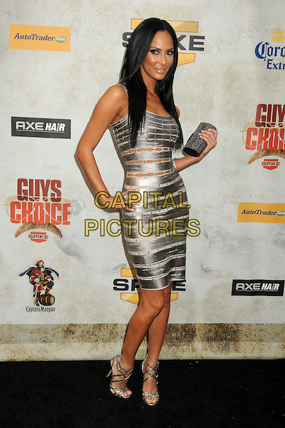"""KENDRA PEREZ .Spike TV's """"Guys Choice"""" Awards 2010 held at Sony Pictures Studios, Culver City, California, USA, .5th June 2010..full length silver shiny cut out dress hand on hip silver sandals shoes clutch bag sleeveless .CAP/ADM/BP.©Byron Purvis/AdMedia/Capital Pictures"""