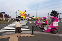 An inflatable Pikachu character and a rickshaw outside the Redbrick warehouse during the third annual Pikachu Outbreak event in Yokohama, Kanagawa, Japan. Wednesday August 10th 2016. The event is hosted by the Pokemon Company. Over 1,000 Pikachu characters are set to appear in week of events from 7th to 14th of August..