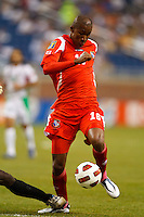 Panama forward Luis Rentería (16) dribbles the ball during the CONCACAF soccer match between Panama and Guadeloupe at Ford Field Detroit, Michigan.