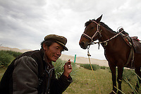 A local Tibetan man near to Qinghai Lake. Qinghai Lake, China's largest inland body of water lies at over 3000m on the Qinghai-Tibetan Plateau. The lake has been shrinking in recent decades, as a result of increased water-usage for local agriculture. Qinghai Province. China. 2010