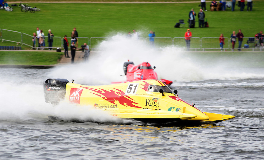 Uvis Slakteris LAT Riga Powerboat Team - Molgaard - A/S,Latvijas Gaze, C J Racing leads Erik Stark SWE Getel Racing Team - Molgaard - Caplease into a corner  ..Powerboat Racing - The UIM F2 World Powerboat Championship of Great Britain - National Watersports Centre, Holme Pierrepont, Nottingham. Sunday 16th September 2012....