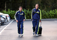 Wednesday 18 September 2013<br /> Pictured L-R: Angel Rangel and Gerhard Tremmel about to board the team coach in Swansea. <br /> Re: Swansea City FC players and staff travelling to Spain for their UEFA Europa League game against Valencia.