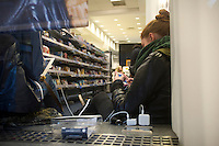 People charge their electronic devices in a Best  Buy in midtown in New York on Wednesday, October 31, 2012. Con Edison is estimating electricity will not be restored back to Lower Manhattan for several more days and a number of businesses are allowing people to charge their batteries.  (© Frances M. Roberts)