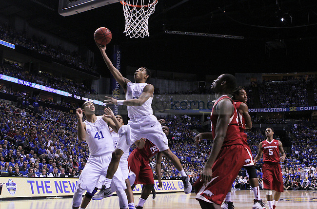 Kentucky guard Tyler Ulis lays the ball up during the first half of the Championship game of the SEC tournament against Arkansas in Nashville , Tenn., on Sunday, March 15, 2015. Photo by Jonathan Krueger | Staff