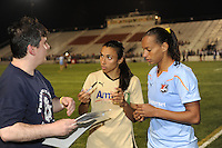 Marta (10) of FC Gold Pride and Rosana (11) of Sky Blue FC sign autographs after the game. FC Gold Pride defeated Sky Blue FC 1-0 during a Women's Professional Soccer (WPS) match at Yurcak Field in Piscataway, NJ, on May 1, 2010.