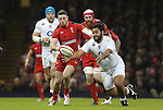 England number 8 Billy Vunipola and Wales wing Alex Cuthbert chase down the loose ball.<br /> 2015 RBS 6 Nations<br /> Wales v England<br /> Millennium Stadium <br /> 06.02.15<br /> ©Steve Pope -SPORTINGWALES