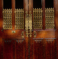 One of a set of doors with intricate metal work designed by A W N Pugin. Each set of doors in the House of Lords has a differently patterned brass grille