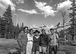 (L-R) Matthew Weston Edward Weston&rsquo;s grandson, Sarah Adams Ansel&rsquo;s granddaughter, Jeanne Adams, Michael Adams Ansel&rsquo;s son, Matthew Adams Ansel&rsquo;s grandson.<br /> <br /> In August of 1987, the family and friends of Ansel Adams made a trip to Mount Ansel Adams to honor Ansel by putting his ashes on the mountain.  Leading the trip were Dr. Michael Adams and his wife, Jeanne, their son, Matthew, and daughter, Sarah.  Also in the group were Ansel&rsquo;s daughter, Anne Adams Helms, and her husband, Ken Helms, and Anne's daughters, Virginia (Ginny) Mayhew and Sylvia Mayhew Desin, and Sylvia&rsquo;s husband, Greg Desin.  Other members of the trip were Roger and Mitzi Hall, Matt Weston, Mrs. Desin (Greg&rsquo;s mother), and Billy Butler.  The Adams family invited me along with Leo Stutzin (Modesto Bee reporter) and my eldest son, Aaron Golub.  <br /> <br /> With some of us on horseback and others on foot, we began the hike at Tuolumne High Sierra Camp and headed to Vogelsang High Sierra Camp for the first night out.  The second day, we began by climbing through Vogelsang Pass, then descended by switchback down to Lewis Creek.  After climbing up from the creek we hiked by the Cony Crags before descending into the Lyell Fork of the Merced River ending up near Hutchings Creek at what is now referred to as the Ansel Adams Camp.  <br /> <br /> This camp was originally known generically as a Sierra Club Camp, but has more recently been referred to as Ansel Adams Camp because in 1934, Ansel led a Sierra Club outing to the Lyell Fork of the Merced River.  After the group climbed the then-unnamed peak that Adams called &ldquo;The Tower in Lyell Fork,&quot; they gathered around the campfire and agreed that the peak should bear Ansel&rsquo;s name.  The U.S. Geological Survey does not, however, permit naming features for living individuals, so the peak did not officially become Mt. Ansel Adams until 1985, one year and one day after his death.  Photo by Al Golub/G
