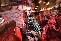 A man donning make up inspired by the Mexican Day of The Dead spirit poses for a photograph during the 41st Annual Halloween Parade. 10.31.2014. Photo by Marco Aurelio/VIEWpress