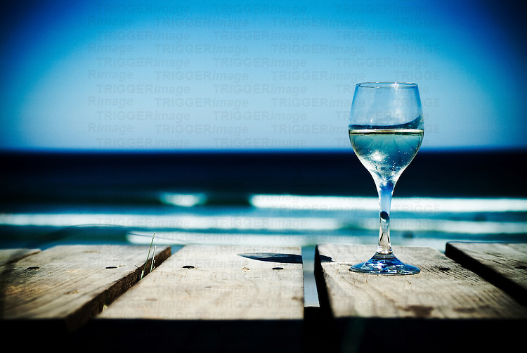 Wine glass on wooden table outdoors