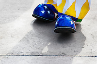 A clown wears oversized blue shoes with stars during the Clown Congress in San Salvador, El Salvador, 18 May 2011. The clown performance is considered a regular job in most of Latin American countries. Clowns may work individually or in groups, often performing advertisement like acts in large open-to-street shops or they take part in private shows, like children birthdays, family events etc. There are many clown conventions all over Latin America where clowns gather and exchange their experiences offering workshops of the comic acting or the art of make-up. For some of them, being clown is a serious lifetime profession.