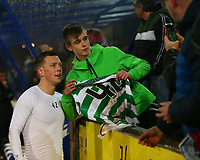 29th January 2020; McDairmid Park, Perth, Perth and Kinross, Scotland; Scottish Premiership Football, St Johnstone versus Celtic; A young Celtic fan gets a picture with Callum McGregor of Celtic after catching his shirt
